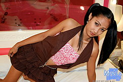 Amanda  Kneeling On Bed Hair In Pigtails