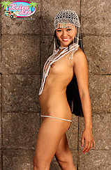 Nude Against Wall Beads Between Her Breasts Erect Nipples