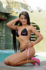 Hand In Long Hair In Bikini Wearing High Heels