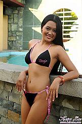 Leaning Against Pool Black Bikini