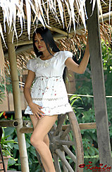Standing Under Roof Wearing White Dress Thighs Crossed