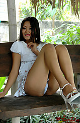 Raising Legs Seated On Bench In High Heels