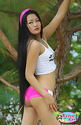 Long Hair Down Her Back In Pink Ribbon Arm Raised Wearing Tight Pink Shorts