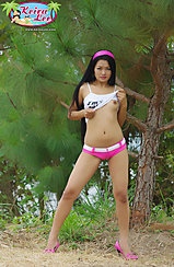 Raising Top Over Her Small Breasts Legs Parted In High Heels Wearing Tight Pink Shorts