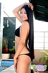 Hand On Her Head Long Hair Down To Her Bikini Bottoms