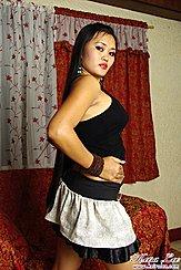Looking Over Her Shoulder Hand On Hip In Short Skirt
