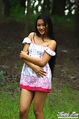 Standing In Field Arms Folded Under Her Chest Wearing Off The Shoulder Dress
