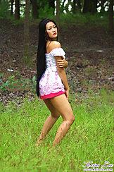 In Field Wearing Dress Long Hair Down Her Back