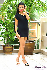 Standing On Patio Wearing Little Black Dress In High Heels