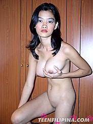 Alma Chua Standing Nude Holding Big Tits
