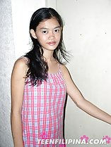 alma chua wearing dress