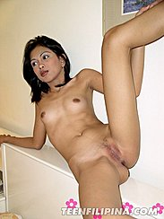 Leg Raised Baring Shaved Pussy
