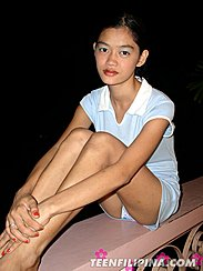 Alma Chua Sitting On Balcony