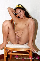 Filipina Beauty Sitting Naked On Chair Hand On Bare Pussy