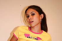 Filipina Mae Rosel posing on bed and flashing small tits
