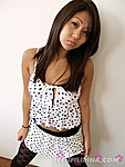 Christine Chan Wearing Polka Dot Dress Long Auburn Hair