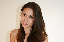 Long haired Filipina Hapa Manapul posing topless on bed