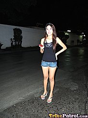 Filipina Rhian Standing In Street In Black Top And Denim Shorts