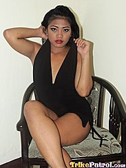 Sitting Cross Legged On Chair In Black Dress