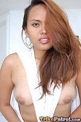Pulling Top Taut Between Her Breasts Long Hair