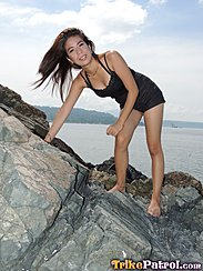 Standing On Rocks Hair Blowing In The Wind