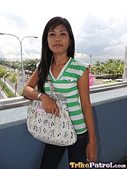 Overlooking Busy Road Long Hair Over Her Shoulder Wearing Green Striped Top Carrying Bag