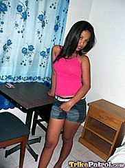 Leaning On Table Long Hair Hidingher Face Pink Top Hand On Her Denim Shorts