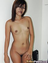 Standing nude hair covering her face small breasts hand on thigh shaved pussy