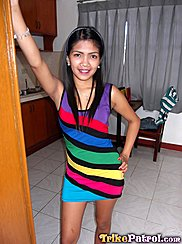 Standing In Doorway Wearing Colourful Striped Dress Hand On Hip