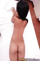 Lying on her front naked on bed bare flat ass