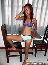 Jennelyn leaning against table in bra and panties bare foot raised onto wooden chair