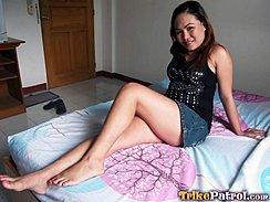 Sitting On Bed Knee Raised Bare Feet