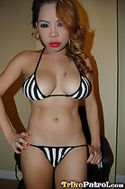 Standing in striped bikini hands on hips