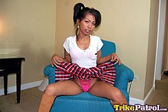 April Seated On Chair Raising Hem Of Skirt Showing Her Panties