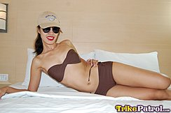 Cindy On Bed In Bikini Wearing Sunglasses