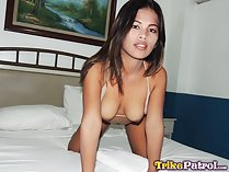 Kneeling on bed breasts exposed